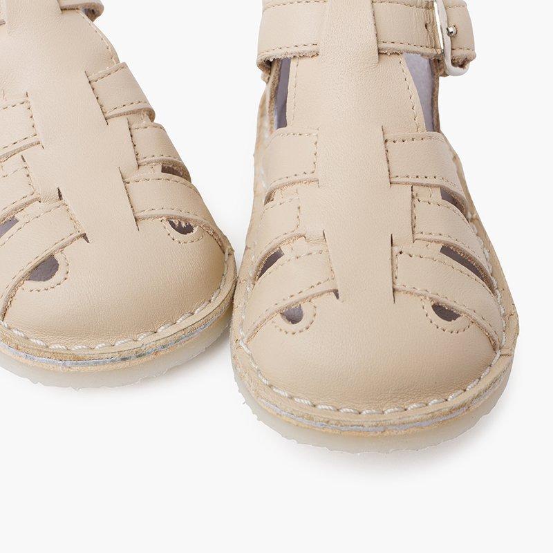 Sandálias de pele!